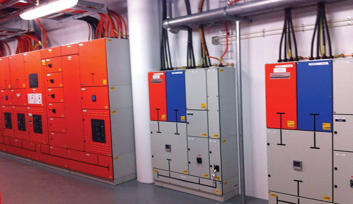 Figure 2. A contractor that understands data centers and a construction management team that focuses on a high reliability data center can help owners achieve their desired goals. In this case, design specifications and build team closely followed the intent of a major data center developer for a clear labeling system of equipment with amber (primary) side and blue (alternate) equipment and all individual feeders. The TCCF process found no issues with Concurrent Maintainability of power systems.