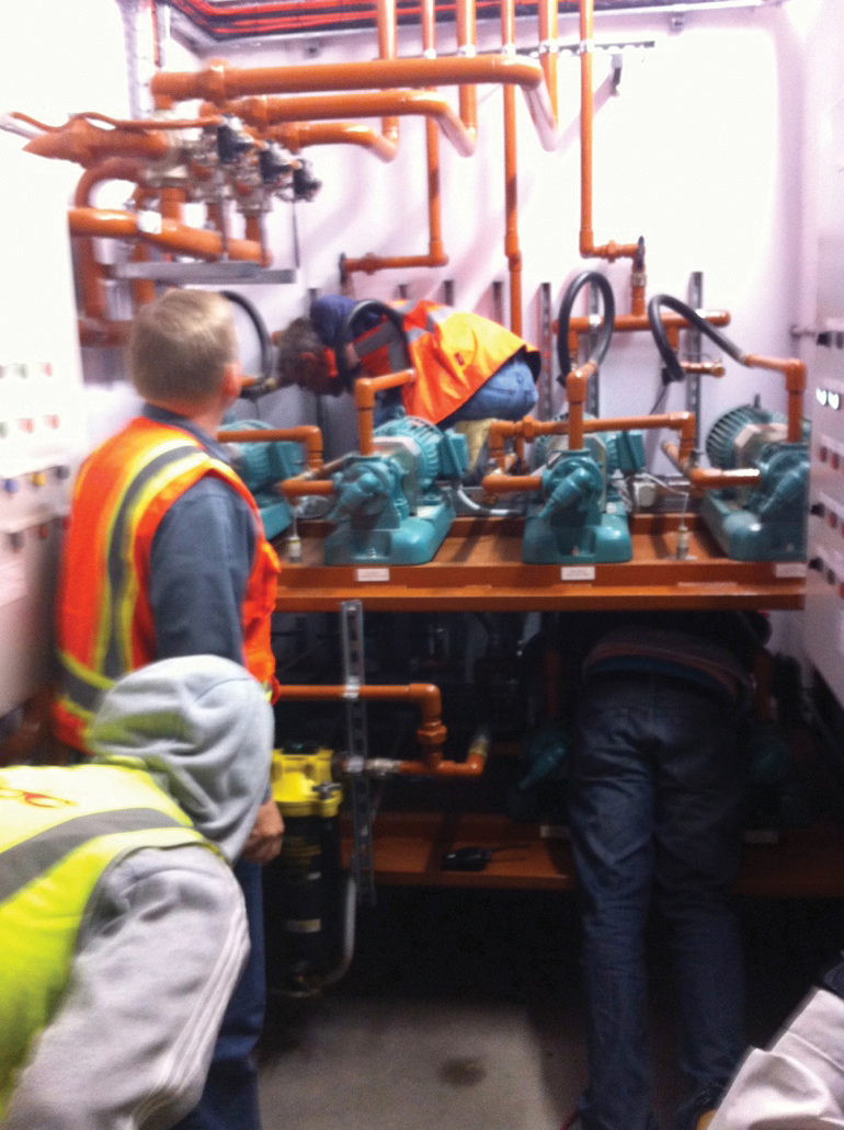 Figure 3. A commissioning team operating valves manually to properly test a fuel supply system. Prior to Uptime Institute's arrival for the TCCF, this task had not been performed.